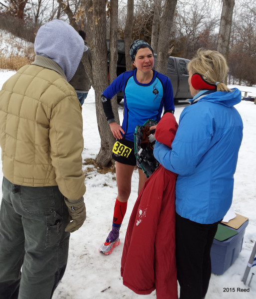 Bronze medalist in the Half,  Robyn Reed asks Mike and Colleen Milloning why they're bundled up so . . . .