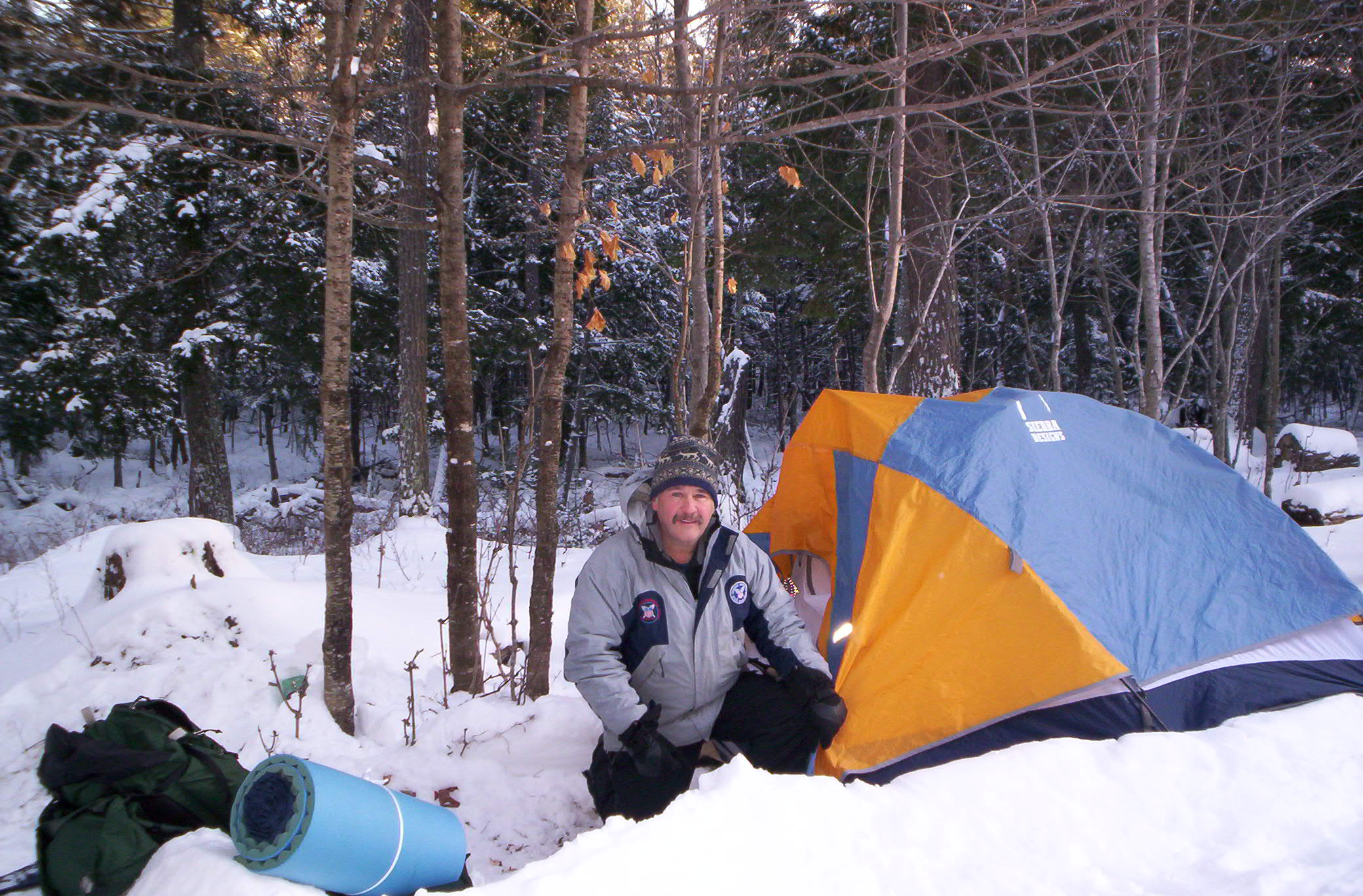 Jim Joque with a tent in the wilderness