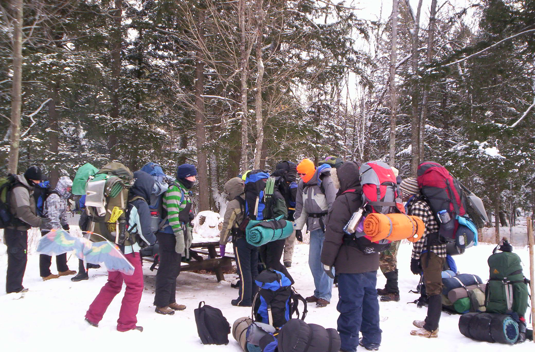 students with packs for winter backpacking