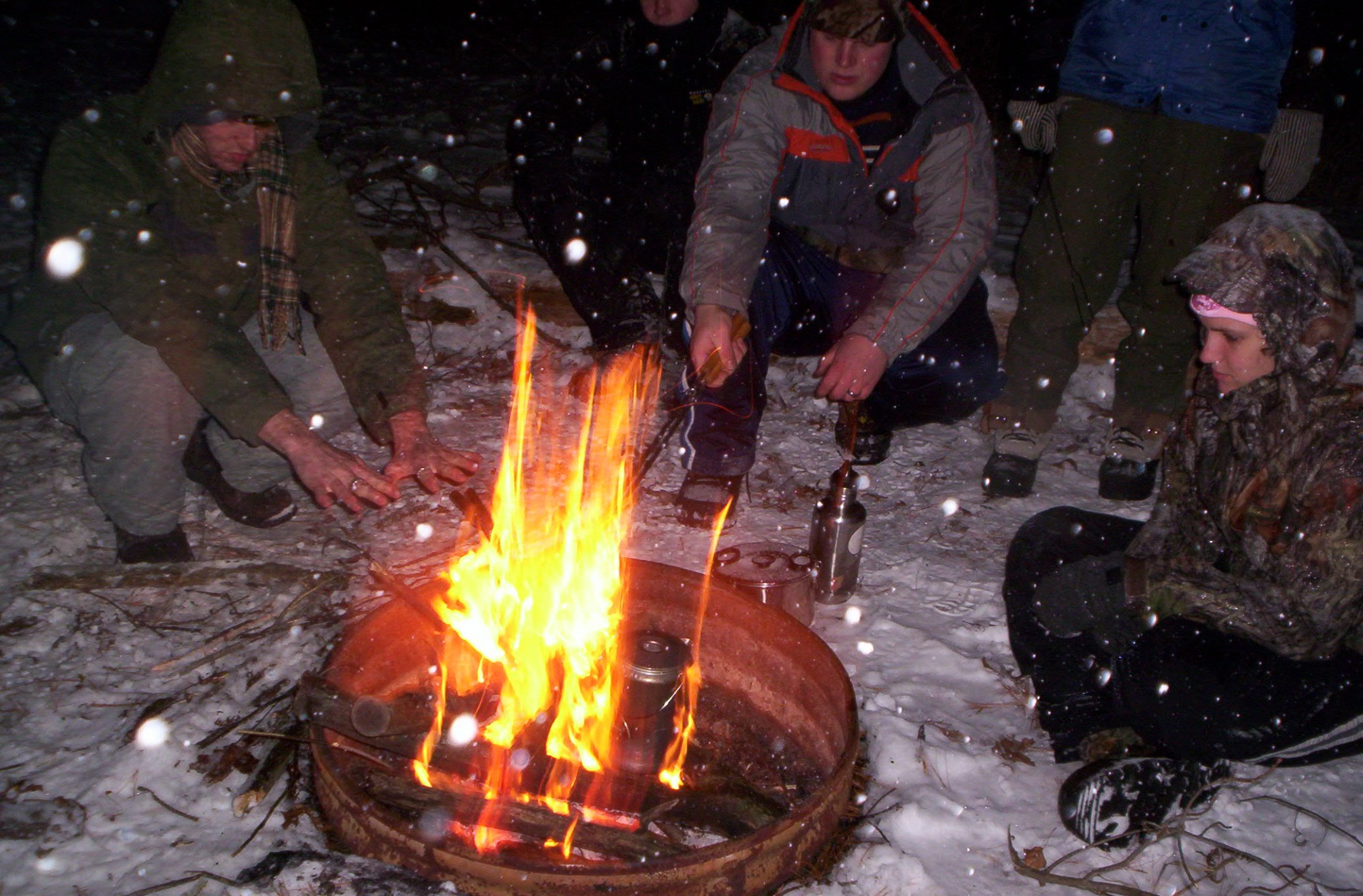 students around a campfire in winter
