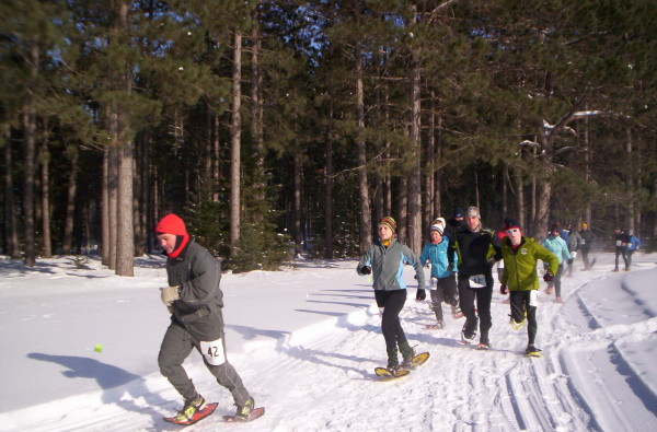 Brian Hallgren (No. 42) leading a pack of racers on his Northern Lites at a 2014 Wisconsin snowshoe race.