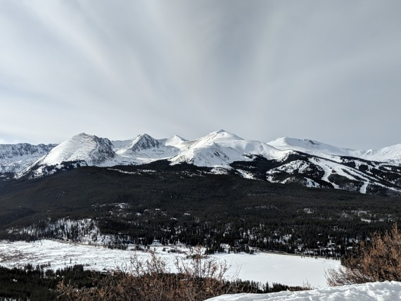 bright, cloudy sky with mountain in background
