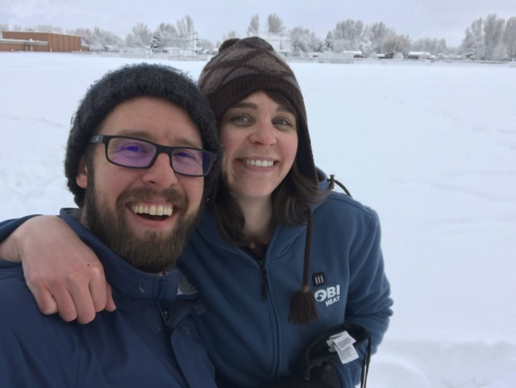 couple posing in park while snowshoeing