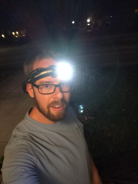selfie of man with Silva Trail Speed 4XT headlamp on nightly run