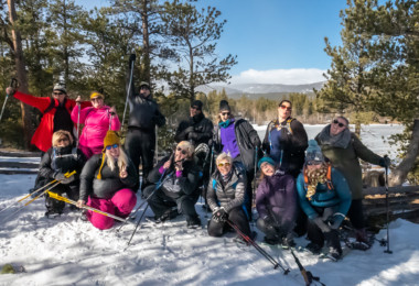 group photo of participants at WNDRoutdoors size inclusive snowshoeing event