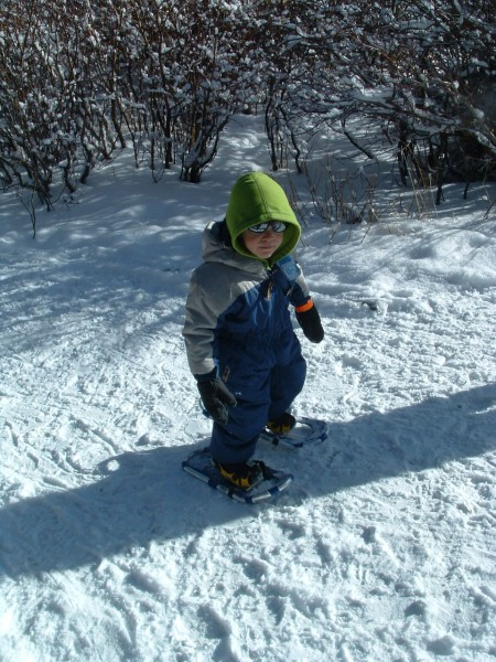 snowshoeing tips for kids: child wearing snowshoes
