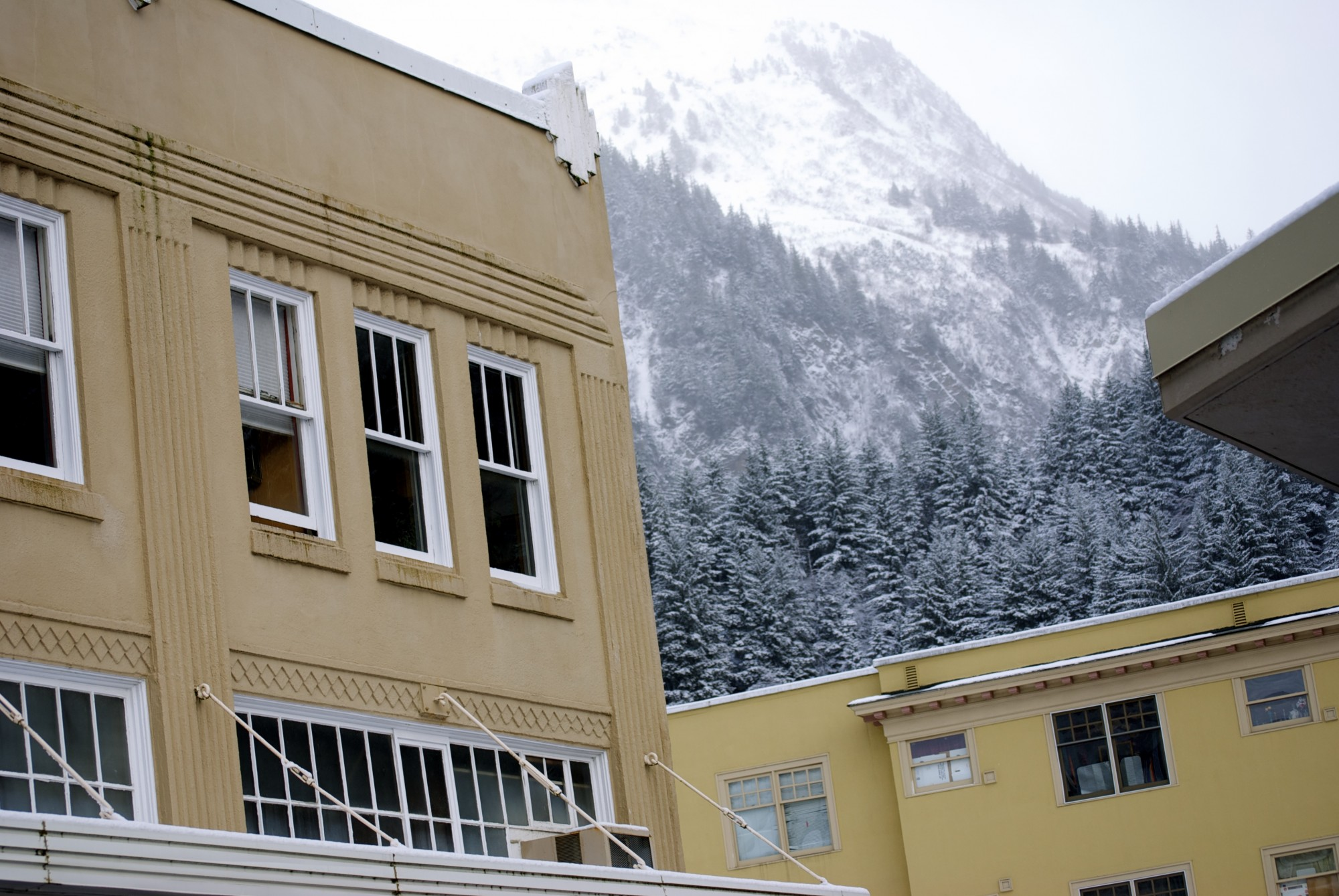 Mountains seem to rise from the backyard of Juneau, Alaska's capital city.