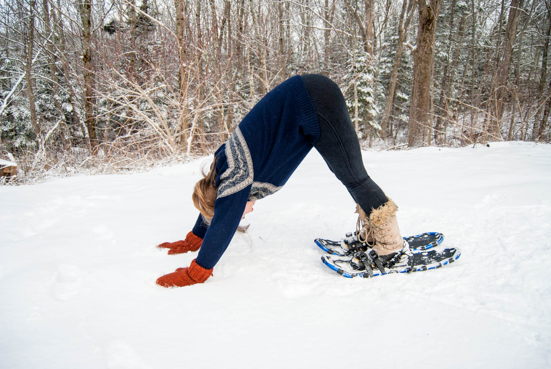 downward facing dog in the snow