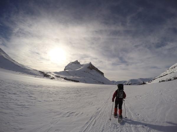 Snowshoeing across Ptarmigan Lake from Skoki Lodge
