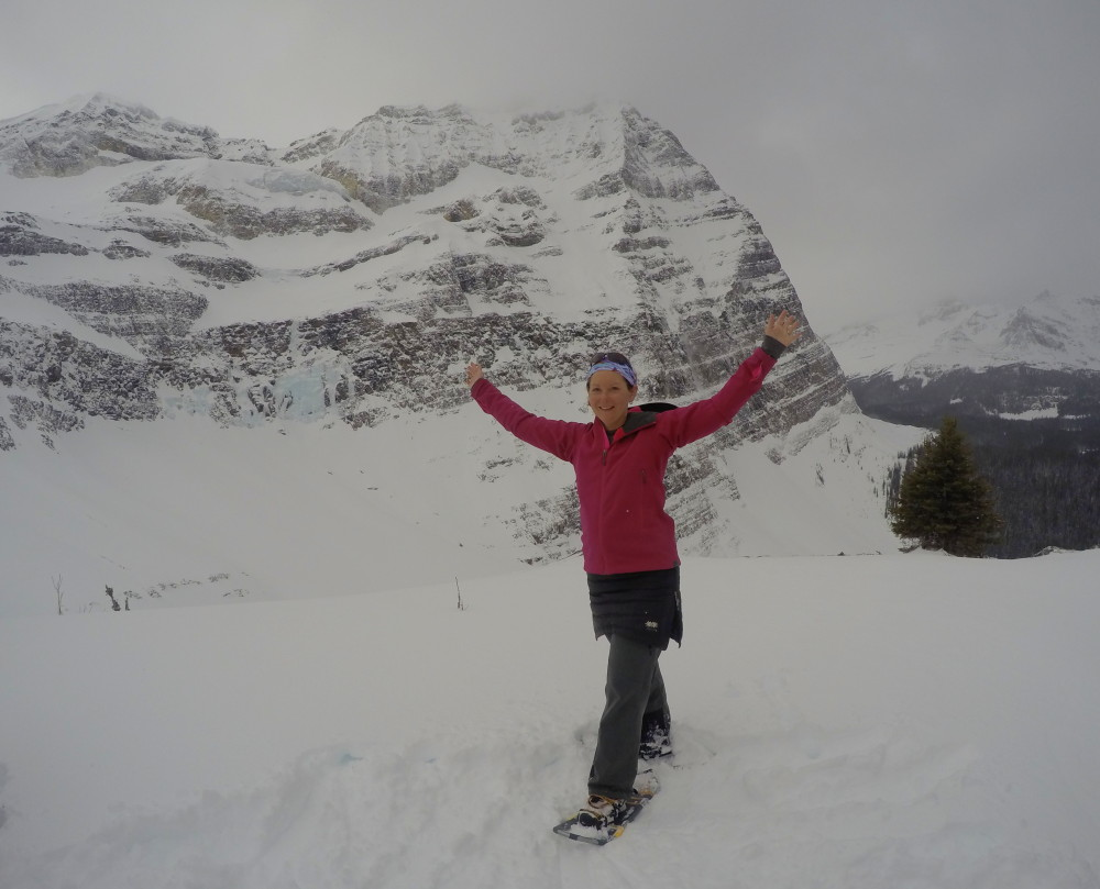 woman with arms outspread at Lake O'Hara Canada