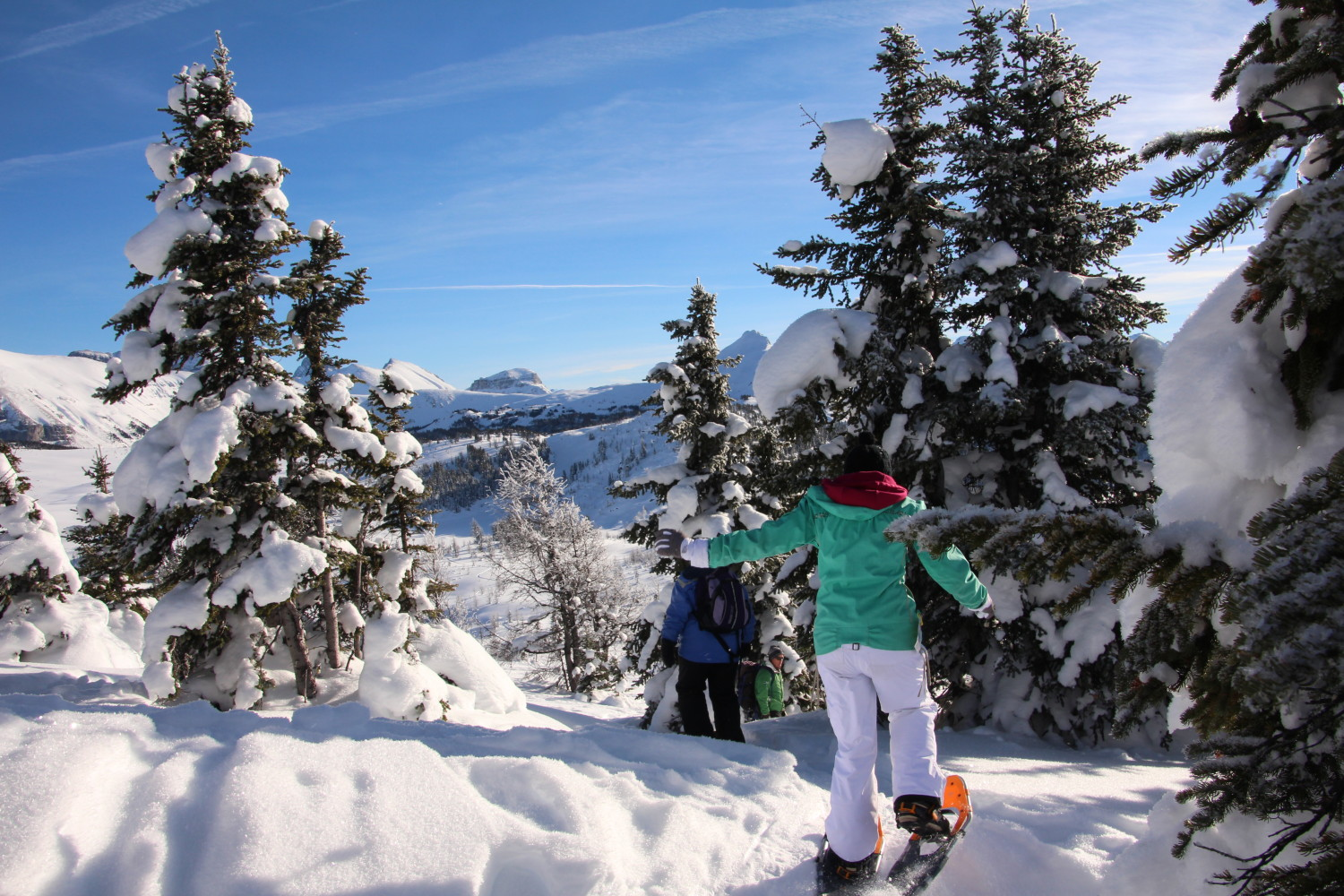 snowshoeing in Canadian Rockies with blue sky
