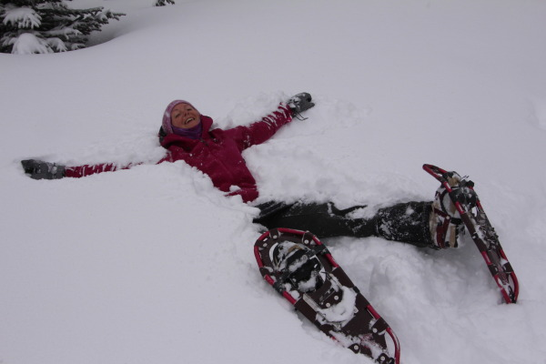 laying in the snow on snowshoes