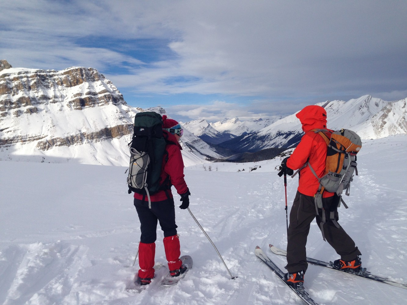 snowshoer and skier side by side in the mountains