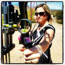 woman shooting archery- Wilderness Athlete