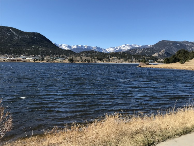 lake with snow capped mountains at Estes Lake Trail in winter