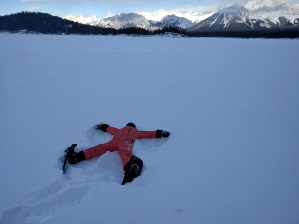 laying on back, snow angel on snowshoes