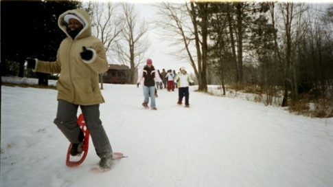 students running on snowshoes