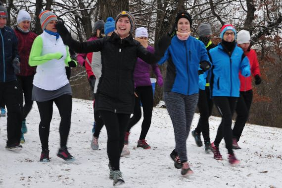trail runners on snowy trail- Ritter Farm Trail Races