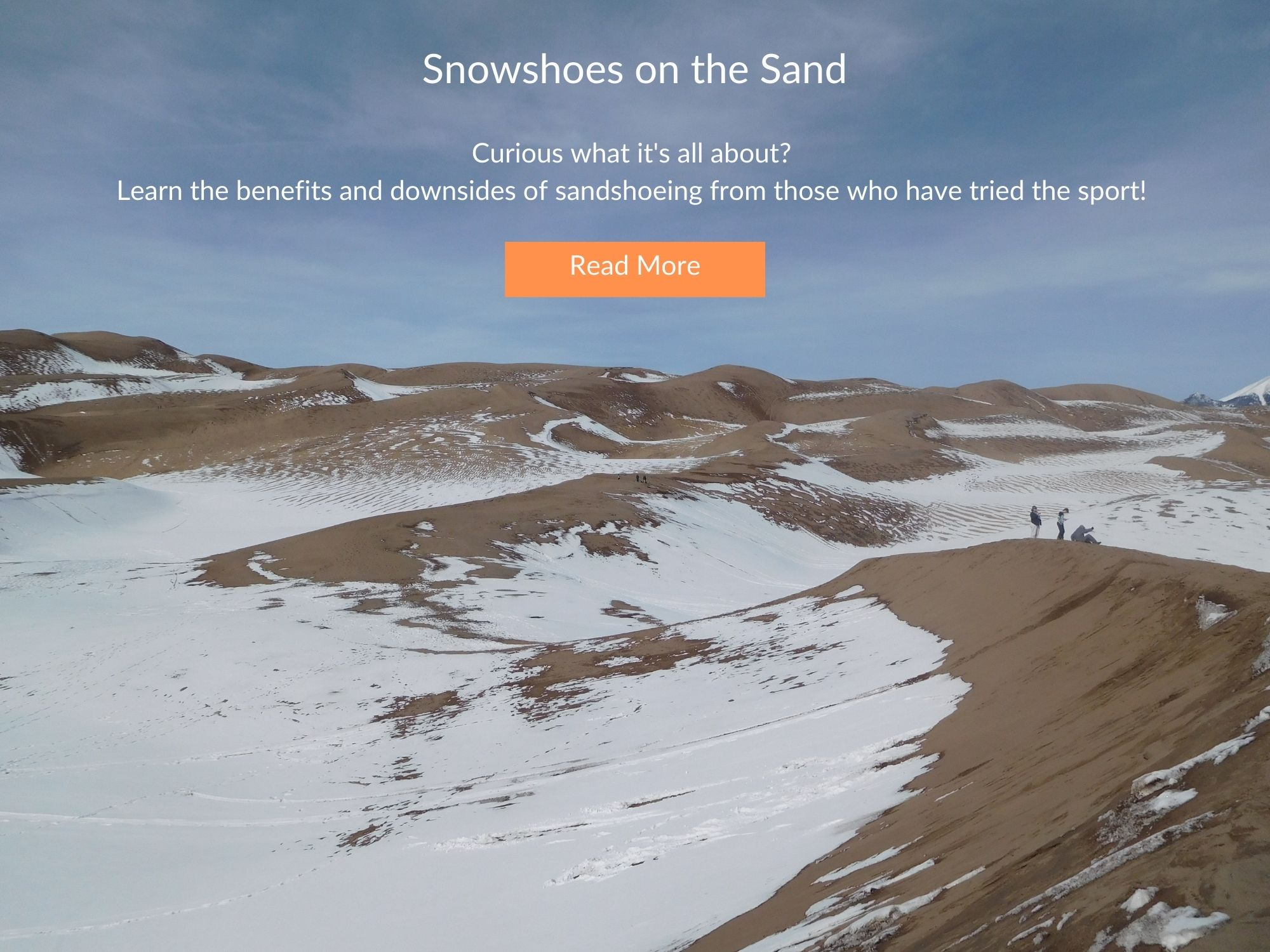 sand and snow with blue sky and text