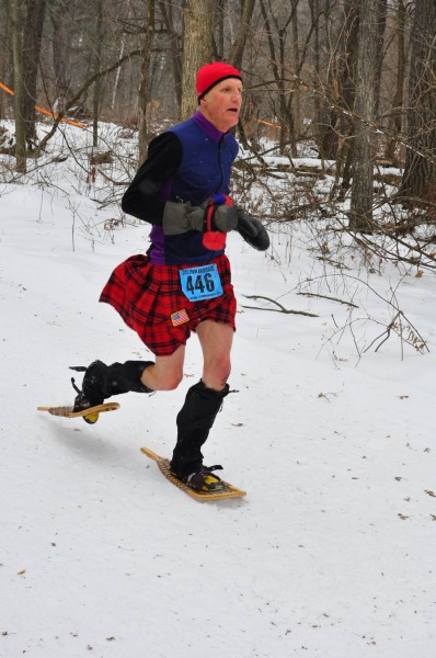 Dave Sykora racing the USSSA National Championships wearing modern wooden snowshoes.