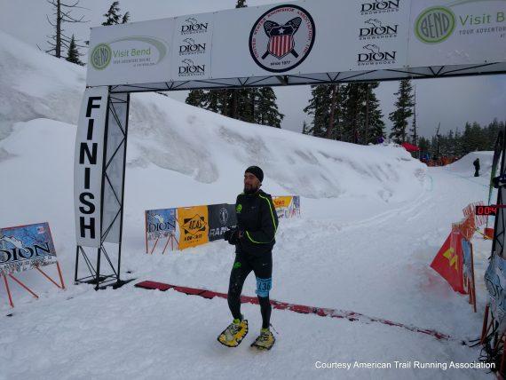 Erik Hartmart running through finishing line