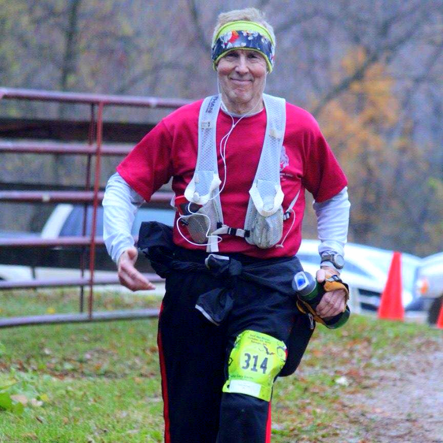 President's Fitness Challenge: man running and smiling with water bottle in hand at 2015 Surf the Murph race