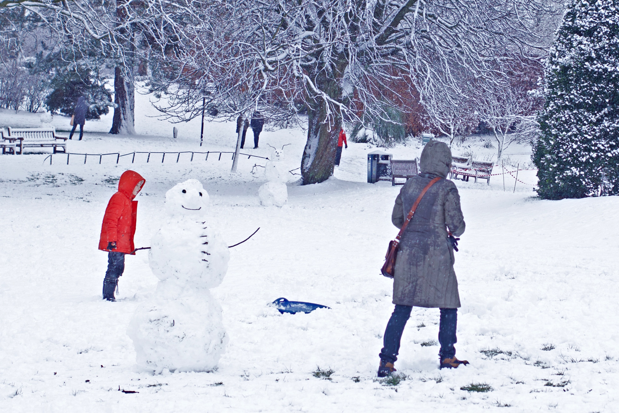 winter in Glasgow Botanic Gardens, woman and child near snowman