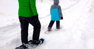 adult and child snowshoeing
