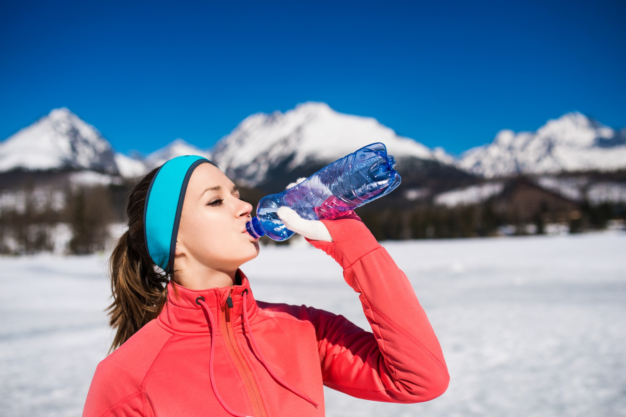 woman during winter activity with water bottle