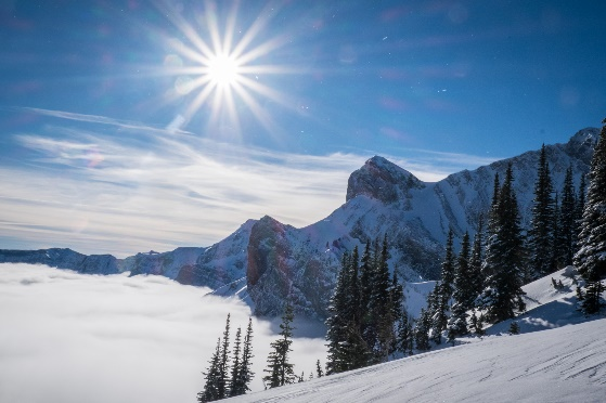 sun shining over mountain, snowshoeing avalanche safety