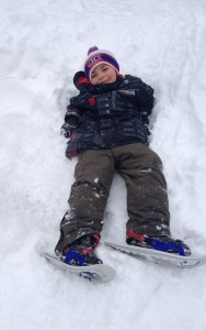 My youngest on his Tubbs Snow Glow snowshoes