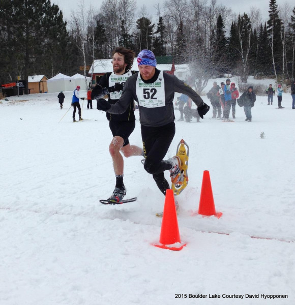 The clock timed them to the exact tenth of a second in the most exciting finish of the day: 52:26.7. Note the ski crowd paying attention to this snowshoe finish!