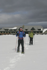 Snowshoeing in front of Highland Center Lodge at Crawford Notch. Credit: Herb Swanson, Courtesy of AMC