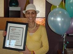 Cindy Brochman with her award, Minnesota, USSSA National Championships
