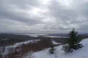 A view from the meadow of Blue Hill Bay and offshore islands, including peaks of Acadia National Park far left.
