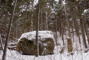 Boulders dropped by a retreating glacier are scattered around the mountain.