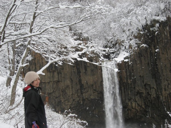 Most beautiful Japanese woman with waterfall near hot spring