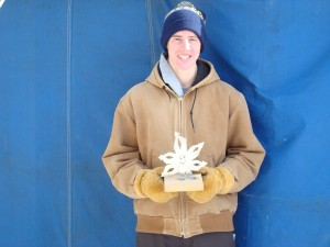 Jeffrey Quednow holding his Snowflake trophy