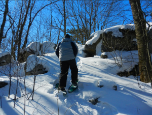 Snowshoeing up steep slopes and over large boulders is typical on Rib Mountain