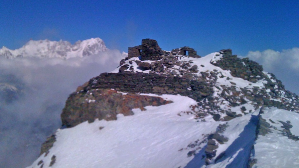Ruins of the castle on the summit, with Grandes Jorasses behind.