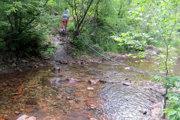 Elk Creek Crossing - your feet are gonna get wet unless you plan to walk the rope, photo by Wayne Nelson