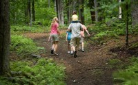 A family hiking at Smuggler's Notch Resort