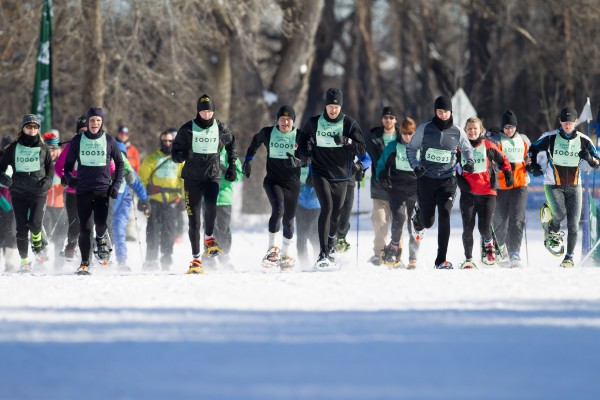 The start of the 2014 1st Annual Snowshoe Loppet race with winner Kelly Mortenson, St Paul (17), Jim Graupner, Lake Elmo (32) Ryan Albu, Mpls (23) and Jose Jorde, Cambridge (34). Women's group are Sarah Pitts, Mpls (12), Pam Nielsen, Minnetonka (3)