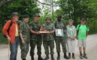Here representatives of the club and the regiment pose on the bridge, which was completed last fall.